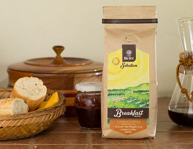 Bread, jam, and Cafe Britt Breakfast Blend coffee