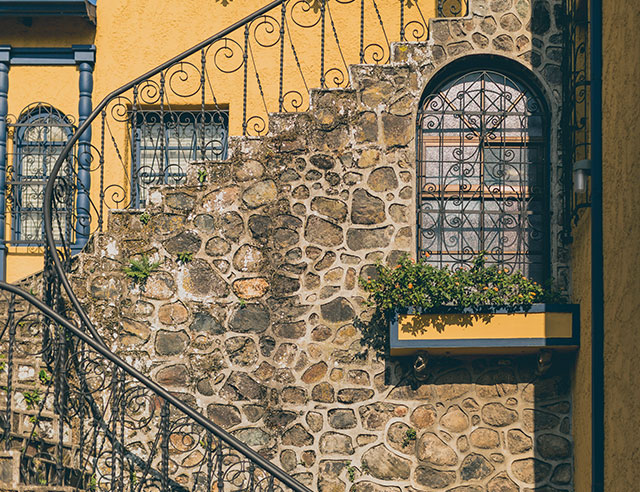 Colonial style building with rustic stones in Barrio Amon, Costa Rica