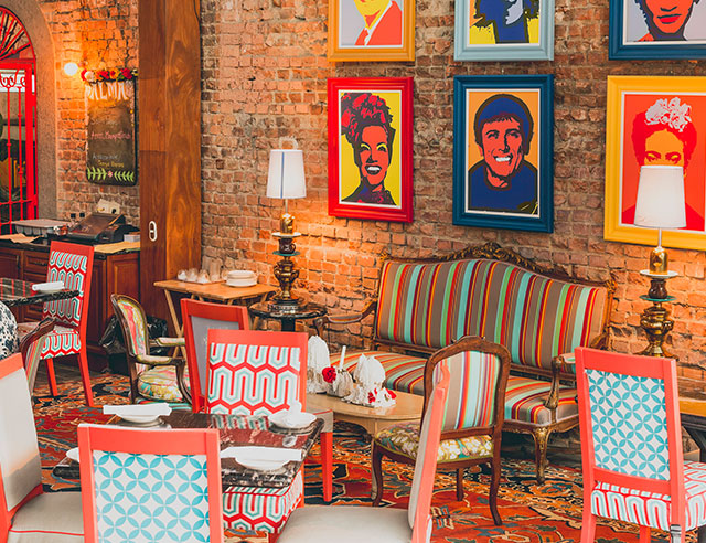 Colorful interior view of restaurant with pop art versions of famous Latinos