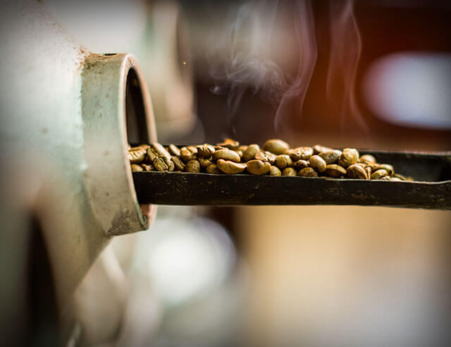 Coffee being removed from a roaster