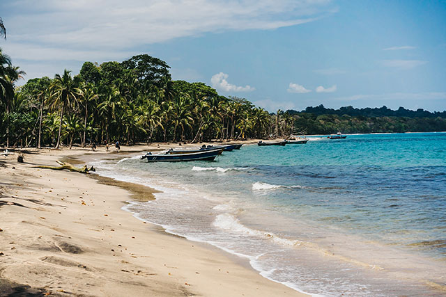 Beach and boats at Gandoca-Manzanillo Wildlife Refuge in Costa Rica