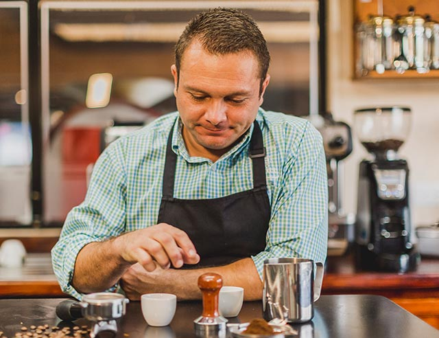 Man reviewing espresso implements