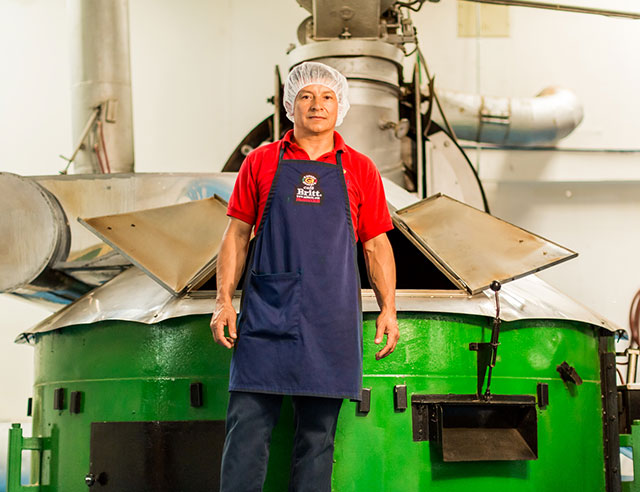 Man in front of coffee roaster