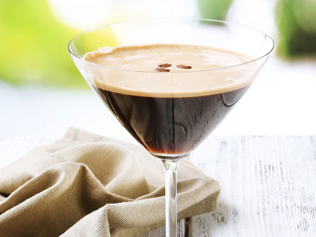 Dark beverage in a martini glass
