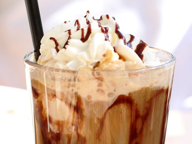 Frozen coffee with whipped cream and chocolate syrup