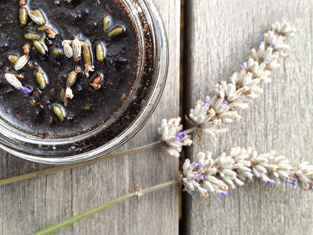 Lavender plant and jar with brown liquid