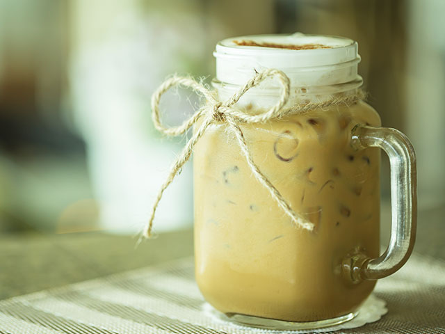 Iced coffee drink in Mason jar glass