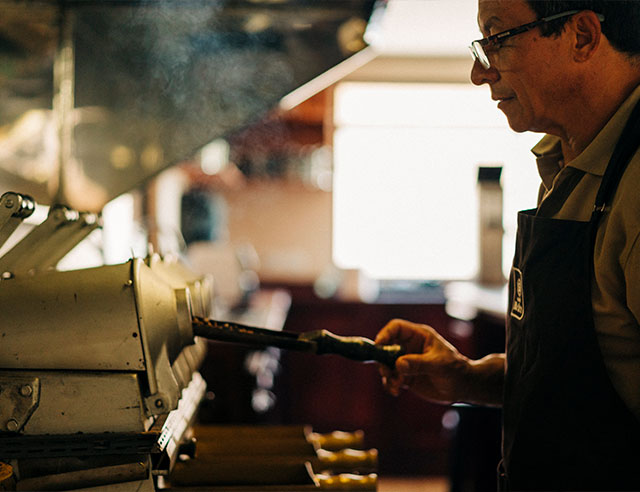 Man looking at roasted coffee